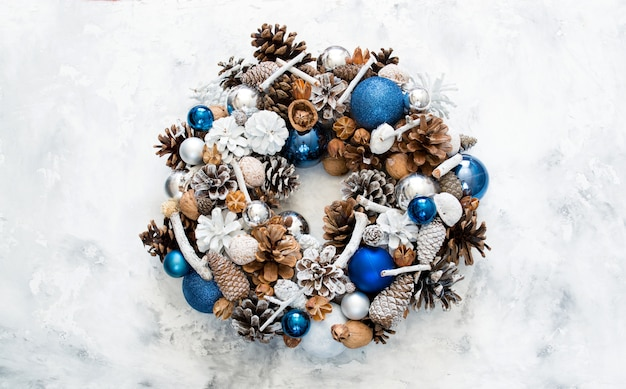 Homemade christmas wreath on a concrete table