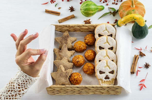 Homemade cinnamon cookie, sweet skull biscuit in the craft eco friendly gif  box. diy sweets halloween