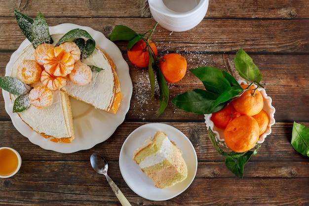 Homemade citrus cake decorated with fresh tangerin. fruit cake.