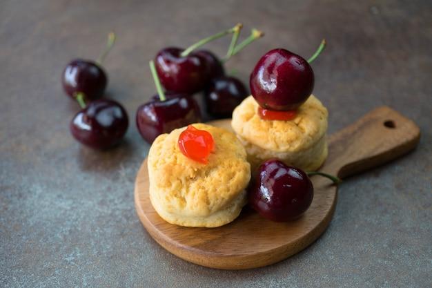 Homemade classic scone with fresh cherries