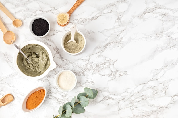 Homemade clay facial mask. zero waste eco friendly diy beauty products ingredients on light wall, flat lay, top view