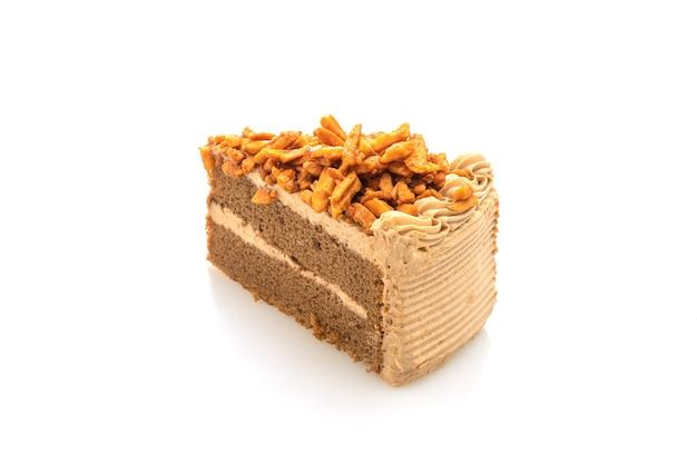 Кусочек домашнего кофейного миндального торта на белой тарелке