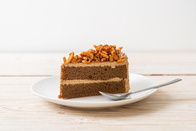 Homemade coffee almonds cake on white plate