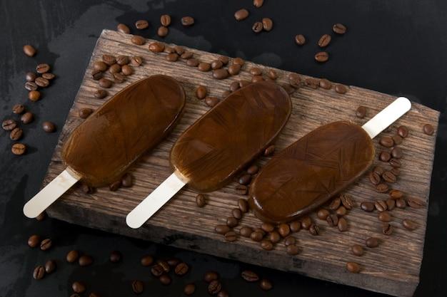 Homemade coffee chocolate ice cream on a dark background, summer cold dessert