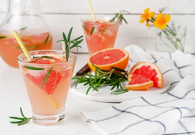 Homemade cold lemonade of grapefruit and rosemary. antioxidant drink