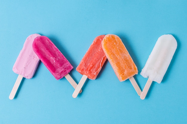 Homemade colourful popsicle ice cream flat lay