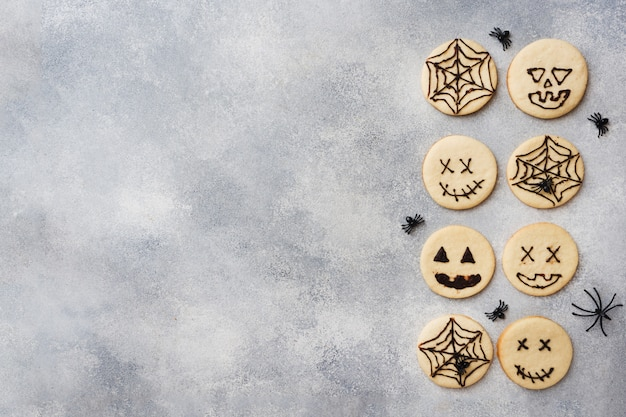 Homemade cookies for halloween, cookies with funny faces and spider webs