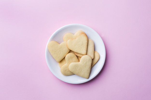 Homemade cookies in the shape of a heart.