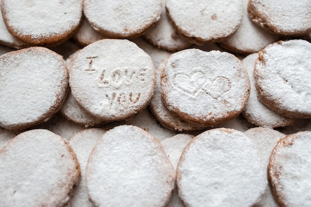 Homemade cookies with sugar powder decoration i love you inscription hearts shape print