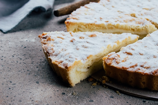 Homemade cottage cheese pie cake on stone table
