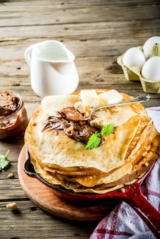 Homemade crepes with chocolate sauce