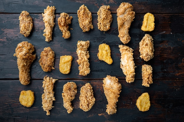 Homemade crispy fried chicken parts on old dark wooden table
