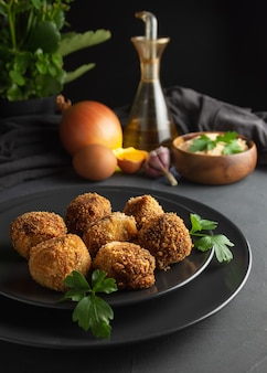 Homemade croquettes on dark wooden background