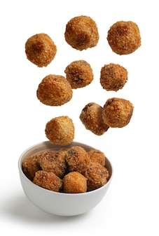 Homemade croquettes flying isolated