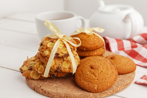 Homemade crunchy cookies and  tea on a wooden table