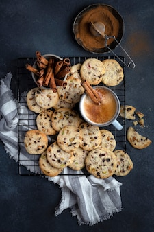 Homemade crunchy cookies with pistachios, cherry and butter