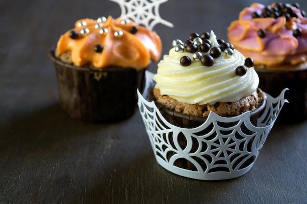 Homemade cupcakes with cream. on dark background.
