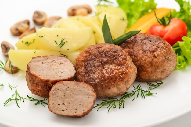 Homemade cutlets with potatoes and vegetables