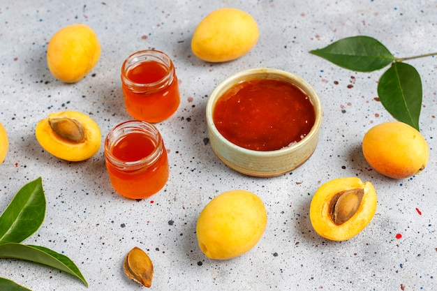 Homemade delicious apricot jam with fresh apricot fruits.