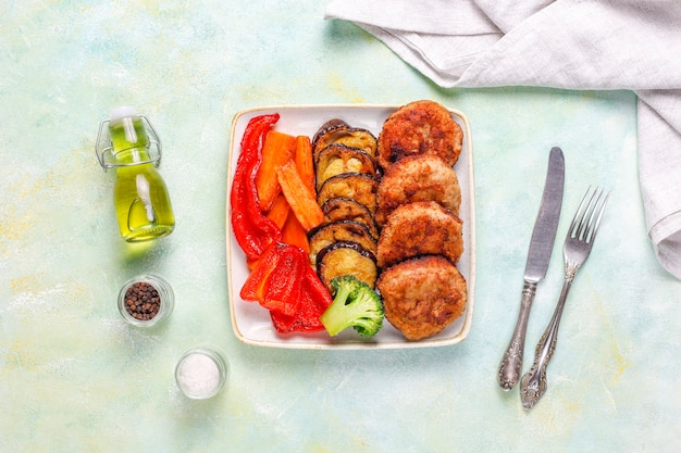 Homemade delicious cutlets with roasted vegetables.