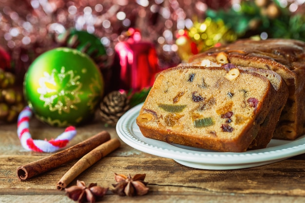 Homemade delicious soft and moist rum fruit cake or christmas fruits cake on wood table