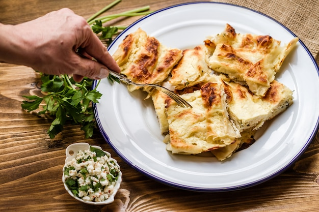 Homemade delicious turkish style cheese pie in enamel plate