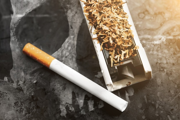 Homemade device for tobacco cigarettes, cigarette harm, death in the background