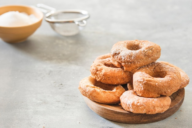 Homemade donuts sugar glazed on a stone background