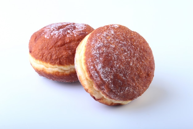 Homemade doughnuts with jelly filled and powdered sugar isolated on white.