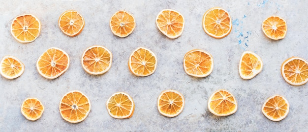 Homemade dried oranges slices top view background