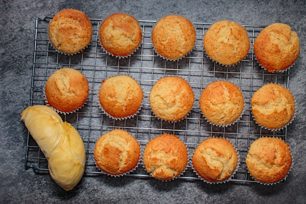 Homemade durian cupcakes on rock table.