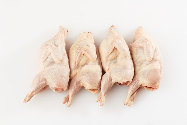 Homemade eco-friendly raw quails ready for cooking.