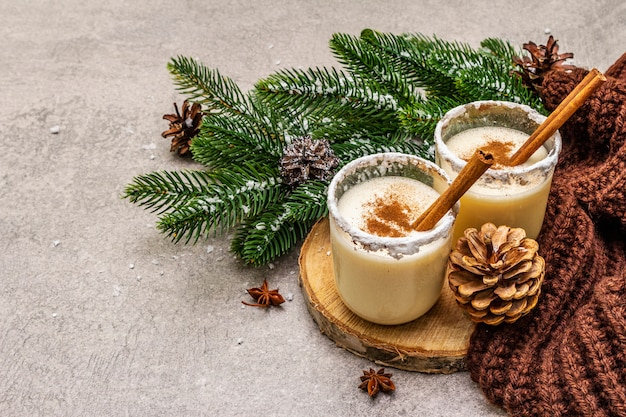 Homemade eggnog with cinnamon in glass.