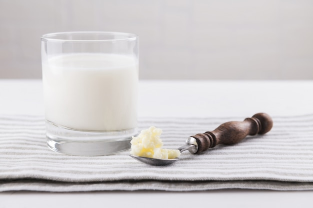 Homemade fermented beverage kefir with kefir grains in bowl on a white background, concept of natural fermented food and intestinal health