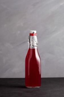 Homemade fermented healthy drink in glass bottle