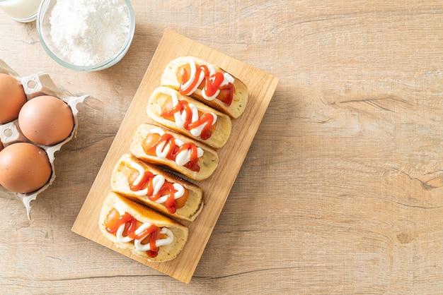 Homemade flat pancake roll with sausage