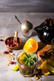 Homemade flavored orange iced tea on stone background