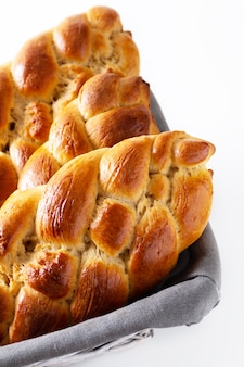 Homemade food concept fresh baked bread braid challah dough in bread basket