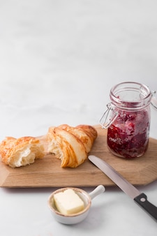 Homemade forest fruit jam and croissant