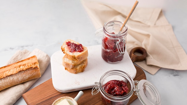 Homemade forest fruit jam and slices of bread