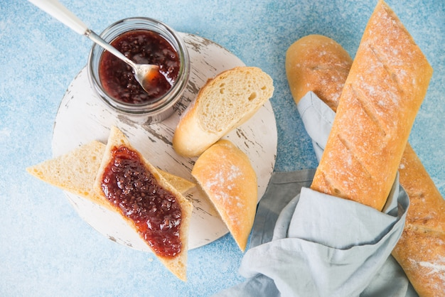 Homemade french baguette with jam for breakfast, simple home-made food