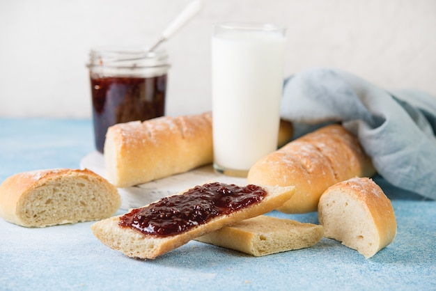 Homemade french baguette with jam for breakfast