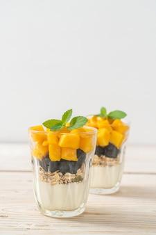 Homemade fresh mango and fresh blueberry with yogurt and granola - healthy food style