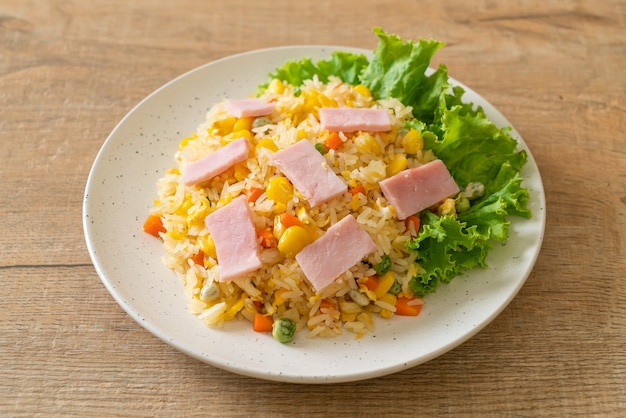 Homemade fried rice with ham and mixed vegetable (carrot, green bean peas, carrot)