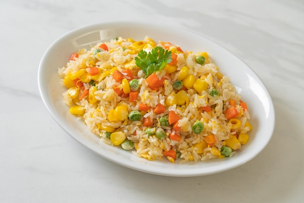 Homemade fried rice with mixed vegetable (carrot, green bean peas, corn) and egg