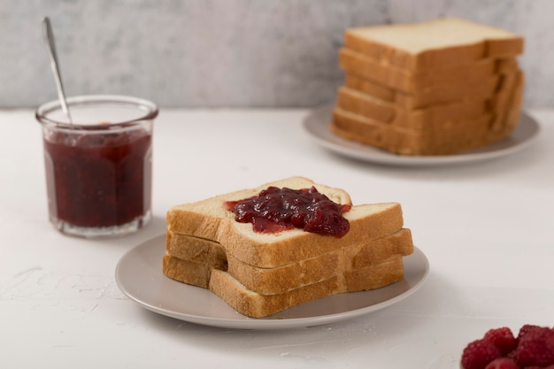 Homemade fruit butter on slices of bread