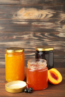 Homemade fruit jam in the jar on grey background. top view