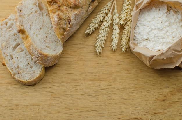 Homemade garlic nut bread on a dark wooden background