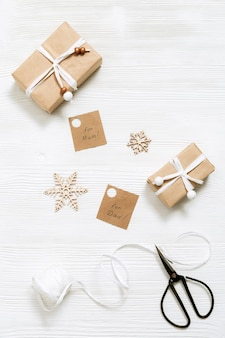 Homemade gift box with tags for family, christmas present box wrapped in kraft paper