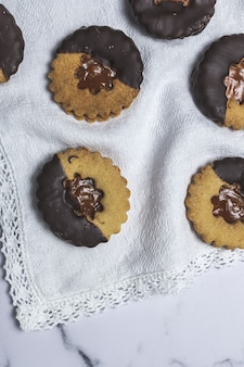 Homemade gingerbread, cinnamon and chocolate cookies on marble background